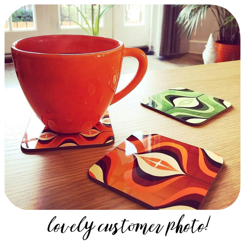 Customer photo of Op Art Coasters with orange mug | The Inkabilly Emporium