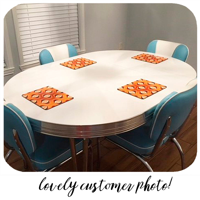 Customer photo of our Orange Op Art placemats all cosy in their new home | The Inkabilly Emporium