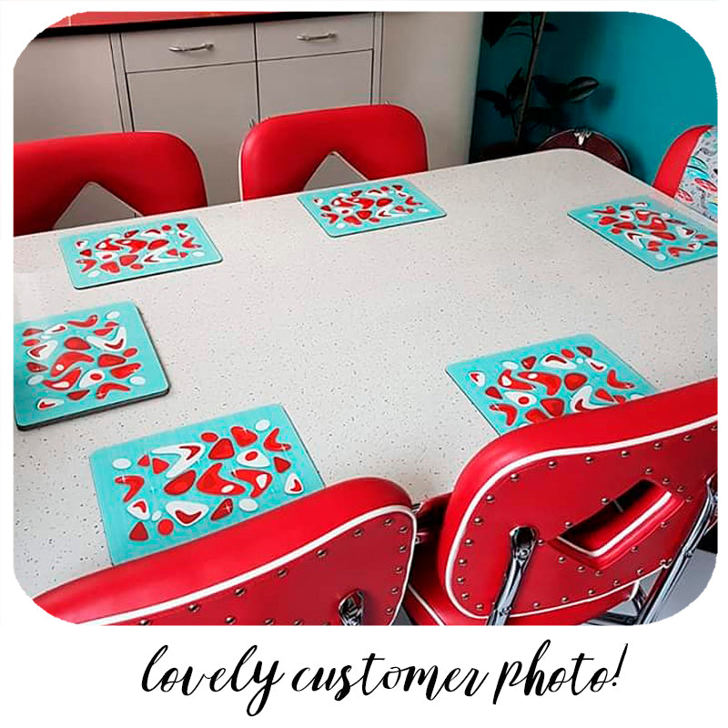 Lovely customer photo of our Atomic Boomerang (aqua & red) placemats in their new home! | The Inkabilly Emporium