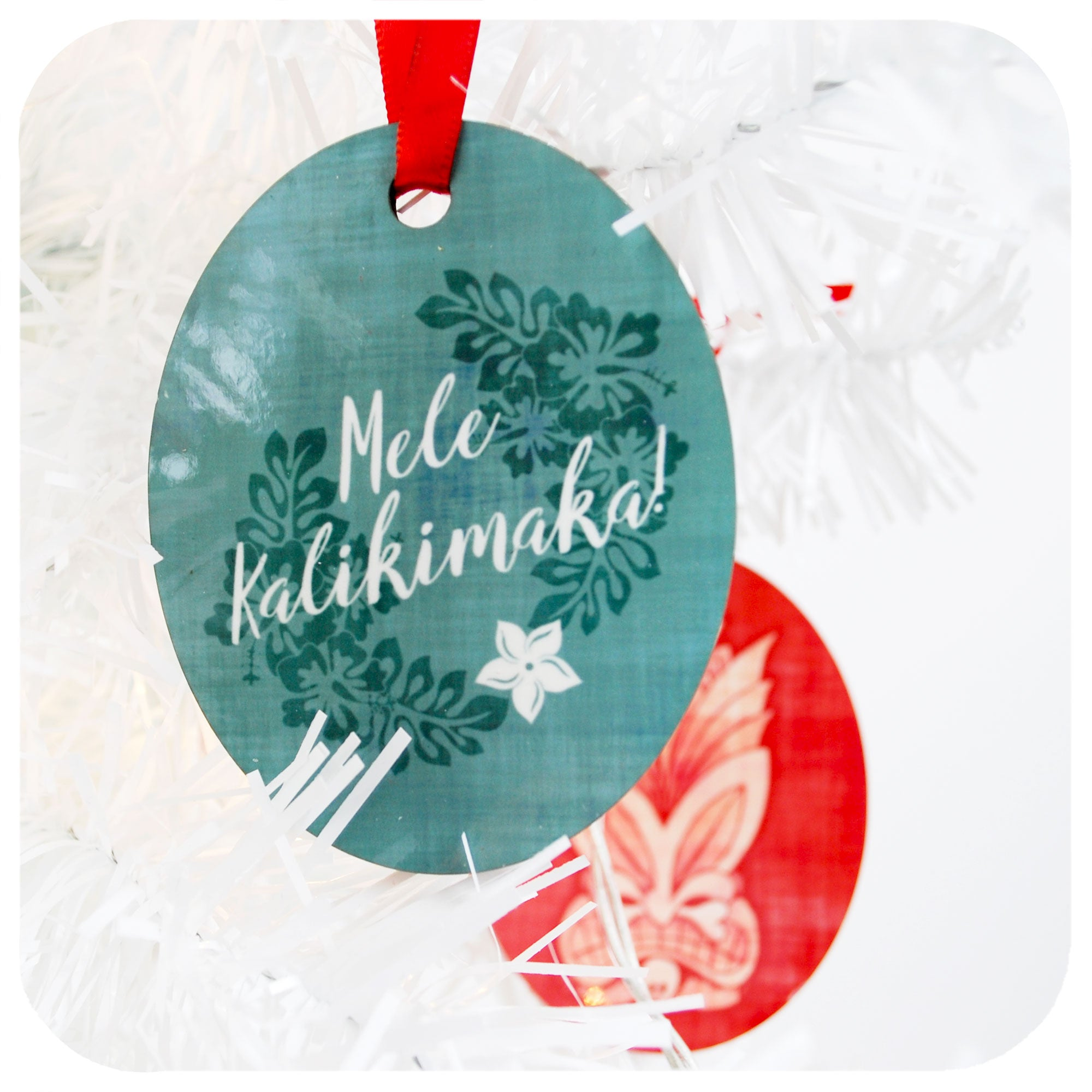 Blue Tiki Christmas Decoration, back reads Mele Kalikimaka | The Inkabilly Emporium