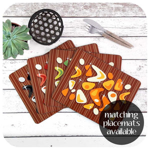 Atomic Boomerang, on teak, placemat set to match coasters  | The Inkabilly Emporium