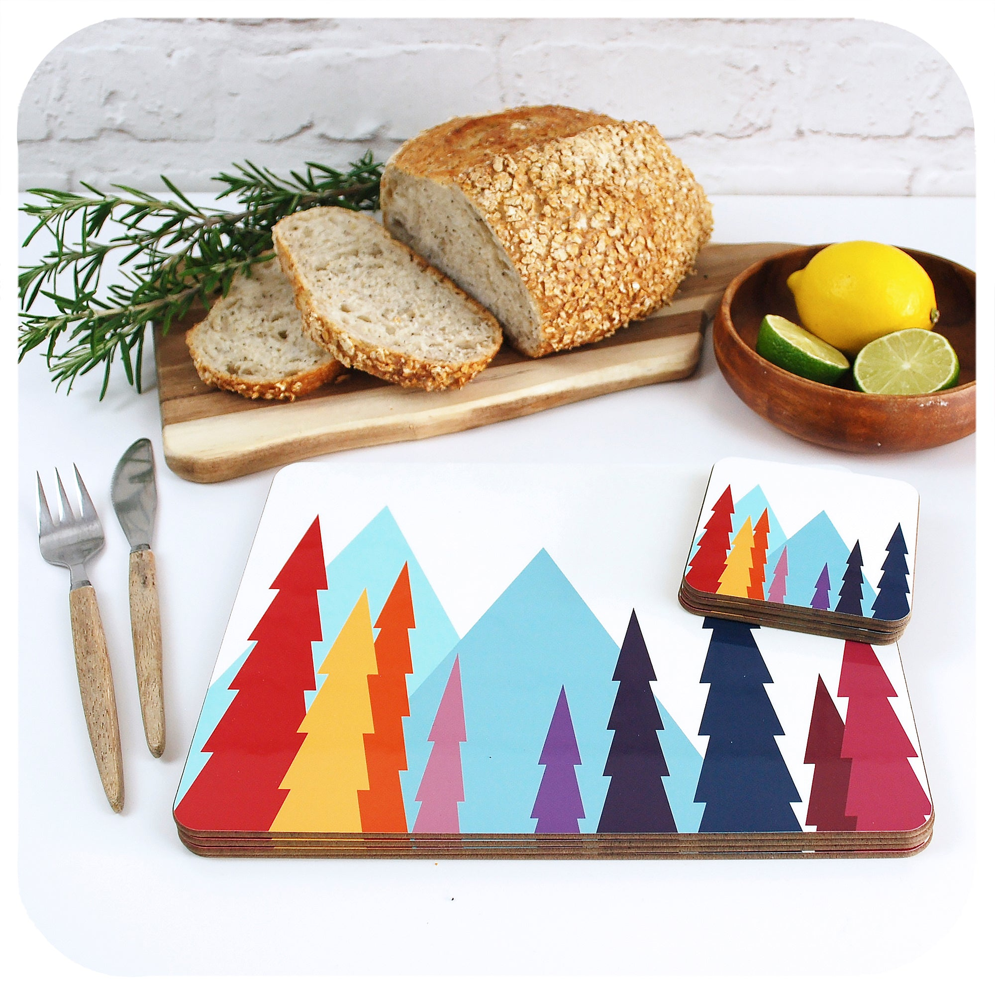 Nordic Trees Placemats and Coasters, on a table with bread and fruit | The Inkabilly Emporium