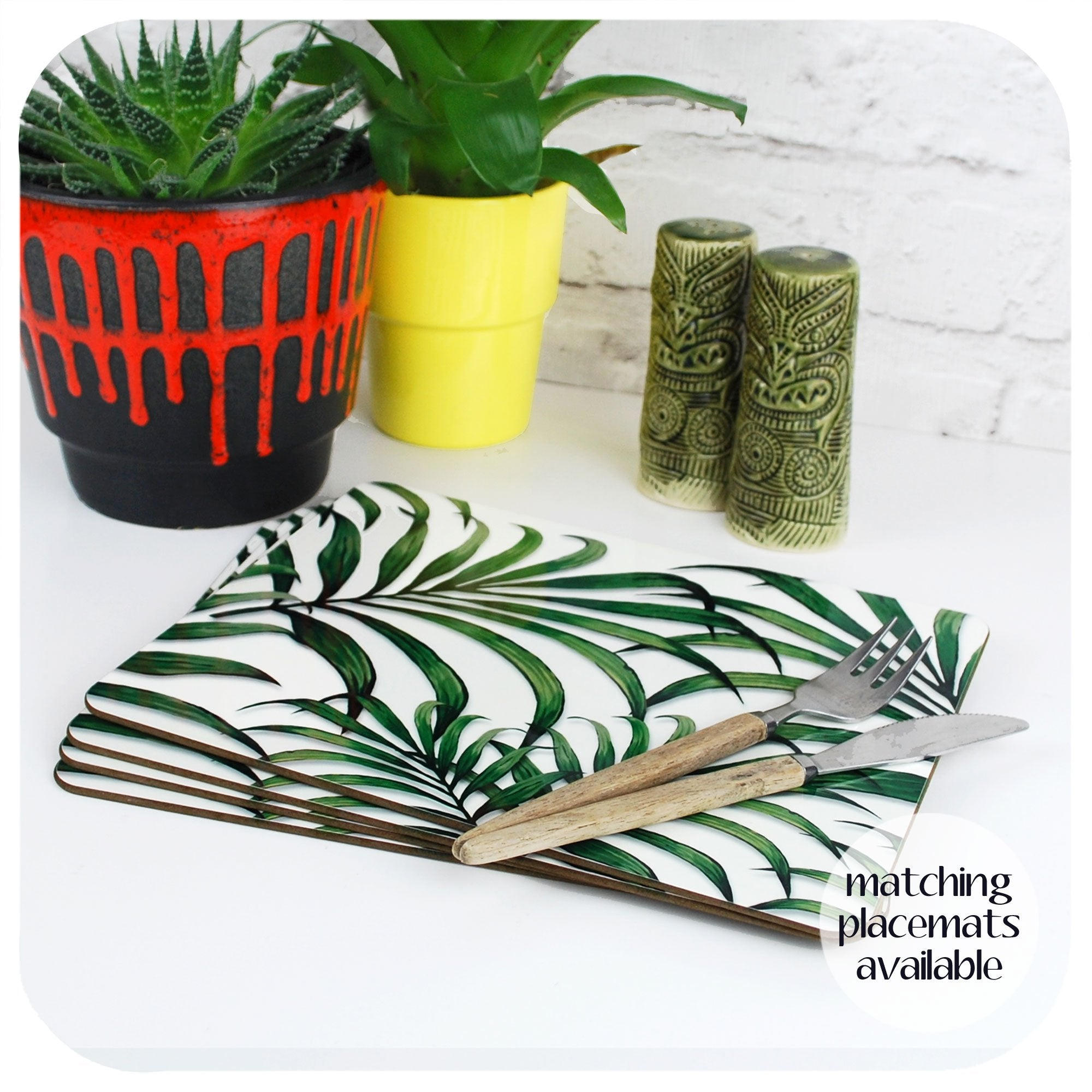 Palm Leaf Print Placemats on a table with plants and Tiki Cruet Set | The Inkabilly Emporium
