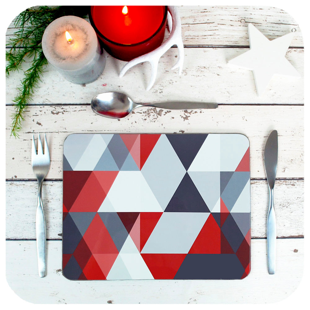 Scandi Geometric Placemats in Red & Grey, set on a table with Christmas candles and decorations | The Inkabilly Emporium