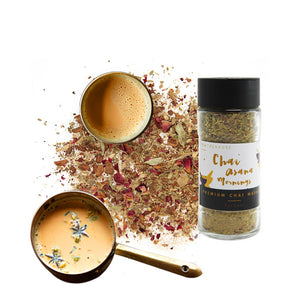 Premium Chai Masala sprinkler with tea leaves.