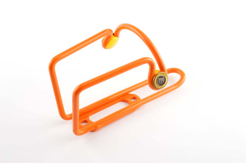 NEW orange Elite Ciussi Light Weigth Tubular Alu water bottle cage from 1990s NOS