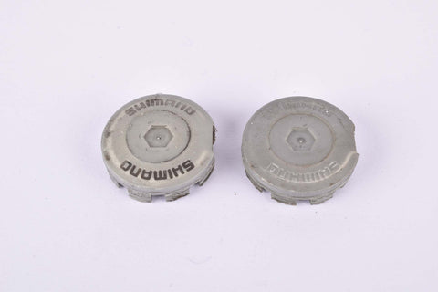Grey Shimano plastic crank set dust caps