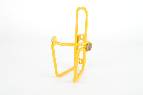 NEW yellow Elite Ciussi Light Weigth Tubular Alu water bottle cage from 1990s NOS