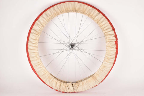 Red and white single wheel cover tire saver