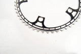 Black anodized and drilled chainring with 52 teeth for Campa cranks from the 80s