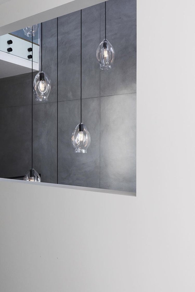 Installed: Fourteen Volt Glass Pendant Lights in a three storey stairwell void.  Glass colour: Clear  Builder: Mould Developments  Cafe Pendant Lights / Restaurant Pendant Lights / Kitchen Pendant Lights / Dining Table Pendant Lights / Pendant Lights