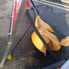 Sandbag used for weight on road sign