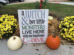 A witch & her little monsters live here with one handsome devil 14x17