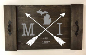 Michigan with arrows crossed