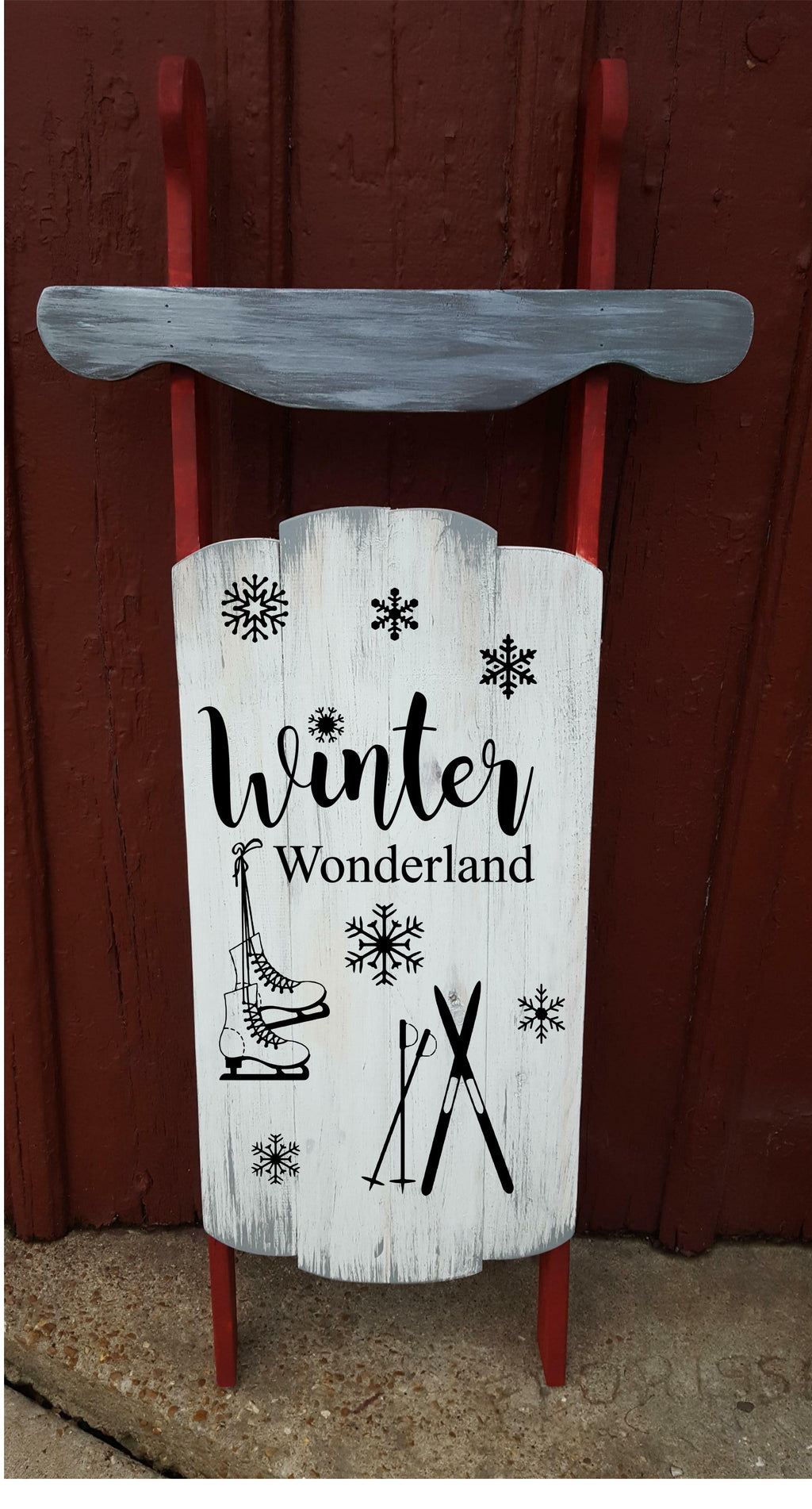 Sled - Winter wonderland with skis and skates