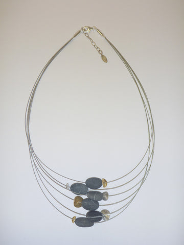 Floating stone necklace by Rena Luxx