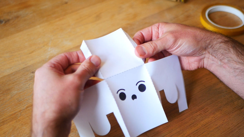 Photo of a partially folded paper ghost