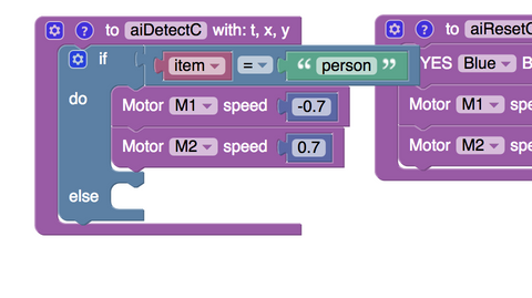 Adding motor blocks to make Smartibot reverse if the A.I. sees a person