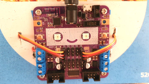 Image of a purple circuit board with two wires attached to it