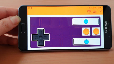 Image of a phone screen with a purple and orange control pad
