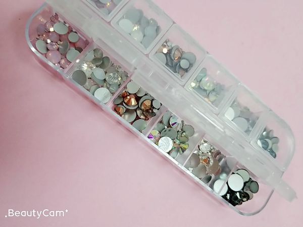 authentic nail art crystals (diamond, charms, gems, rhinestones)