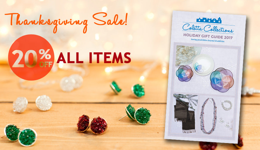 Display of fused glass jewelry and Holiday Gift Catalog 2017 cover
