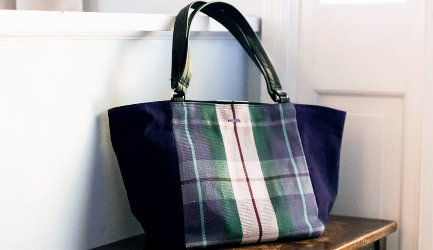 Display of handmade canvas bag with leather handles