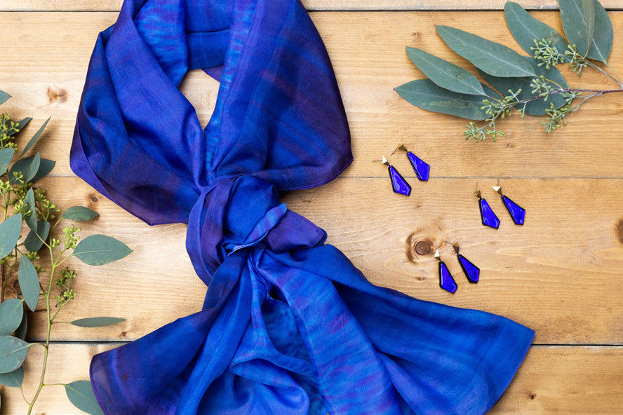 Display of blue scarf and set of blue glass earrings