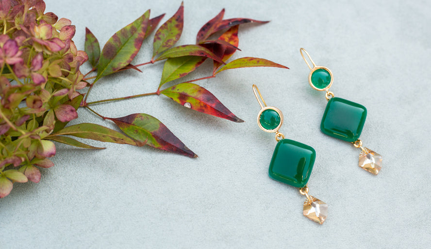 Display of a pair of green stone earrings