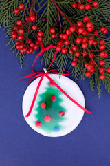 round christmas tree ornament with a tree