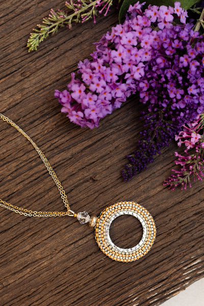 gold and silver beaded pendant necklace