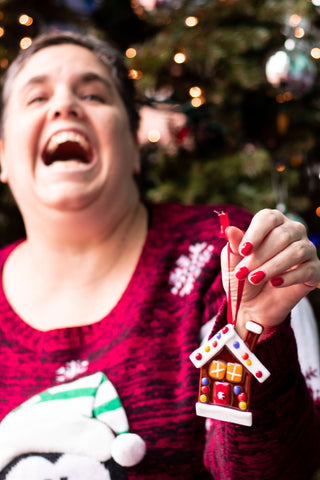 adult with disability hanging christmas ornament in store