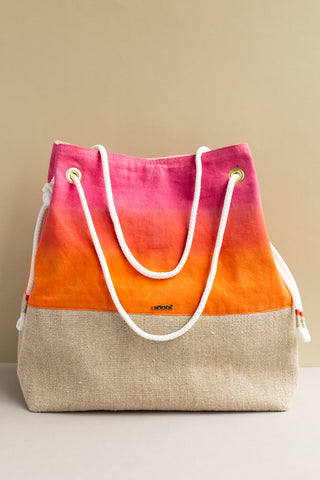 Persephone Bucket bag hand woven and dyed by adults with disabilities in linen bottom band and a pink to orange ombre on top