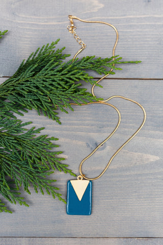 fused glass rectangular pendant in teal with gold triangle finding on top with gold chain made by people with disabilities