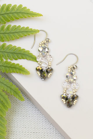 hand made beaded earrings in a chandelier drop style made from silver, gray and clear faceted beads with silver findings