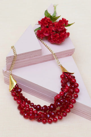 red beaded chunky necklace with gold calla lily findings and gold chain made by people with disabilities