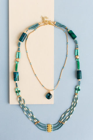 Arboreal Beaded Necklace with two layers made by adults with disabilities in shades of teal, green, cream and gold.