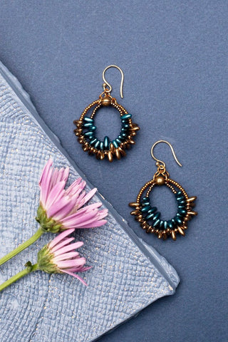 beaded hoop earrings with two loops one in teal and the other in bronze made by people with disabilities
