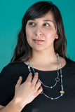 model wearing layered cassia necklace