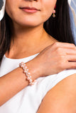 model wearing pink everafter pearl bracelet
