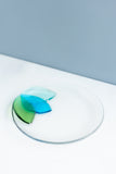 handmade Fused glass appetizer plate with floral petals on one side in shades of blue and green made by people with disabilities