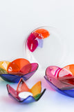 handmade fused glass tableware collection in rainbow colors with a floral pattern handmade by people with disabilities