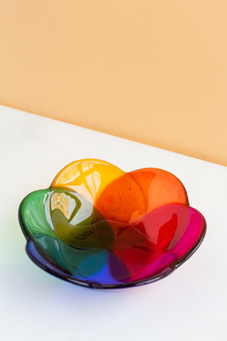 handmade Fused glass bowl in a floral shape in rainbow colors made by people with disabilities