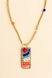 Naida multicolor beaded rectangular pendant with a radiating design and a beaded chain with gold beads and colored faceted beads