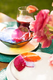 handmade fused glass appetizer plate and bowl in rainbow colors with a floral pattern handmade by people with disabilities