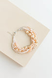 Bliss Chunky Wedding bracelet handmade from beads and swarovski pearls that are custom and made to order bridal accessory in shades of champagne, ivory and peach