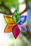 fused glass flower wind chime in rainbow colors close up