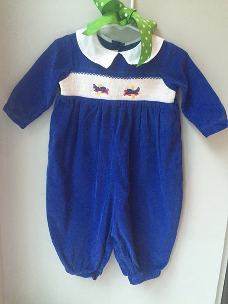 Long sleeve royal blue smocked airplane romper