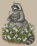 A Raccoon in the Snowdrop Flowers