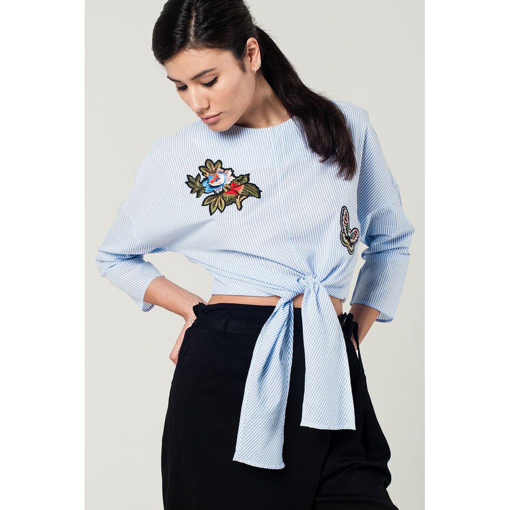 Blue striped top with embroidered patches detail - Stylishme
